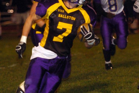 -----Kyle Warmt sweeps for yardage in second quarter action against visiting CBA Friday night in Ballston Spa.