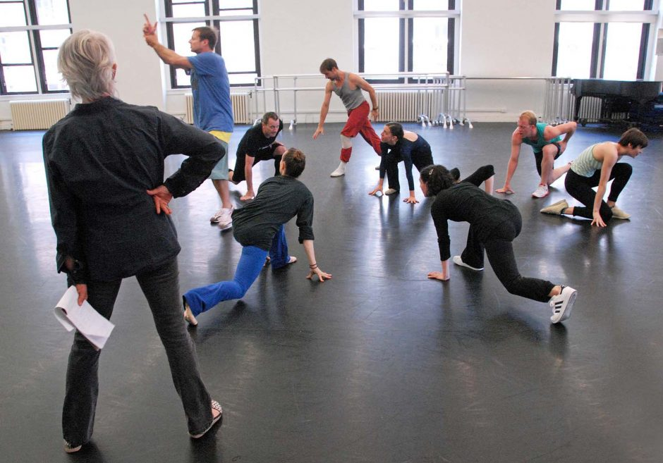 Choreographer Twyla Tharp works with her dancers in the studio.