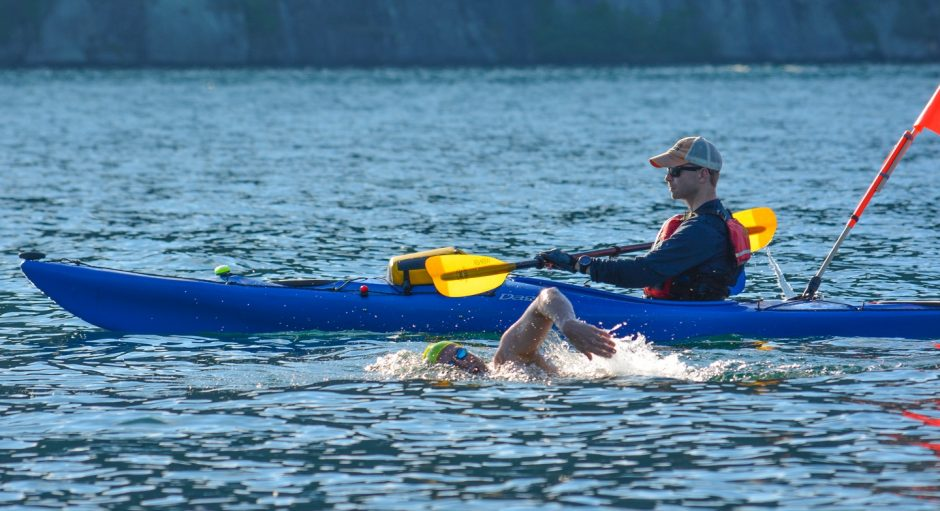 David Dammerman of Saratoga Springs swims through the northern part of Lake George accompanied by crew member Chris Bowcutt in a kayak. Dammerman swam the 32-mile length of Lake George two weekends ago.