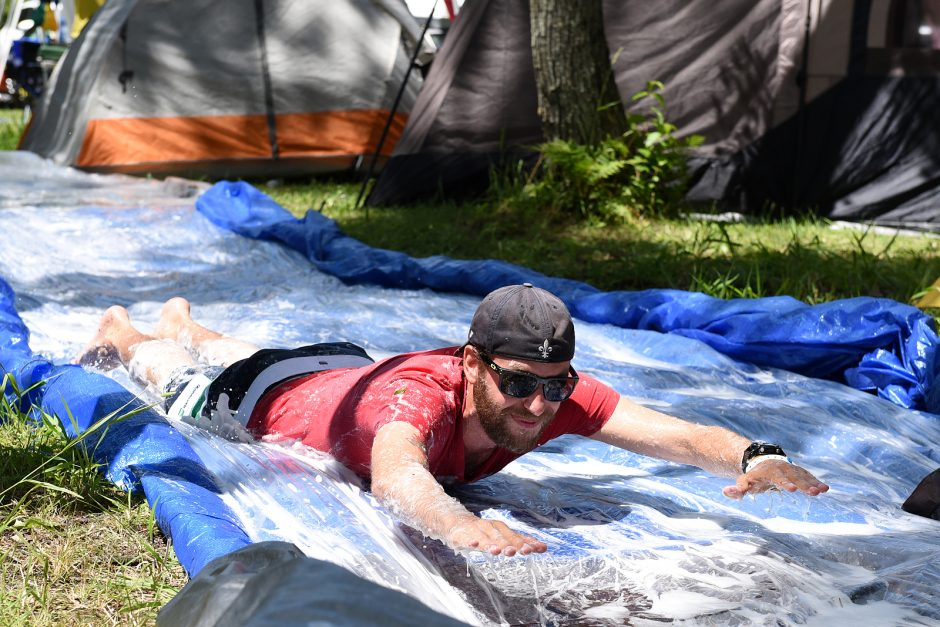 Dan Beatty of Boulder, Colo., enjoys the slide at Lee's Campground on Saratoga Lake during Phish weekend on Saturday afternoon.