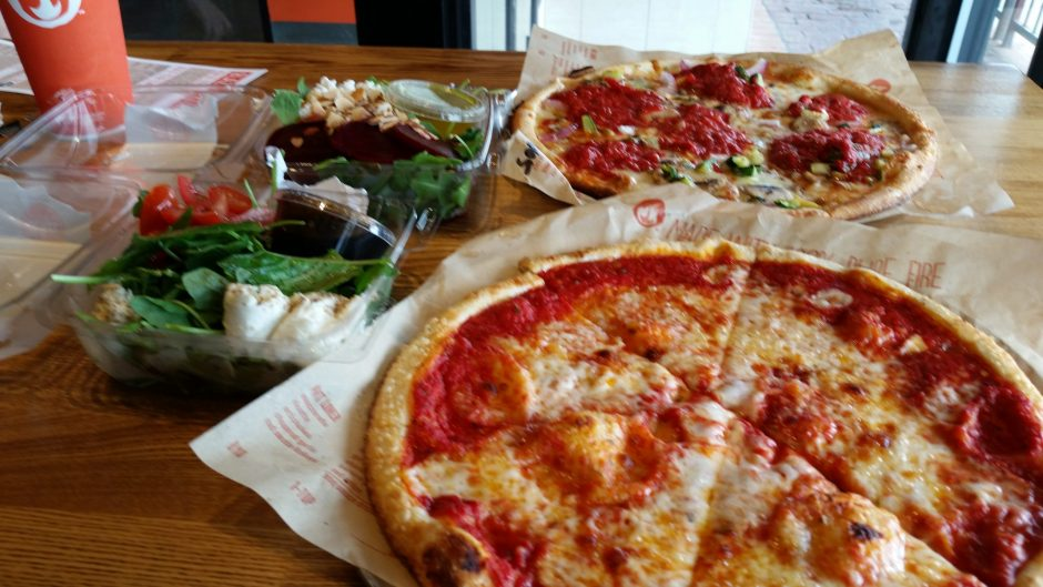 Blaze's Simple Pizza, foreground, and Veg Out Pizza with salads. (Caroline Lee)