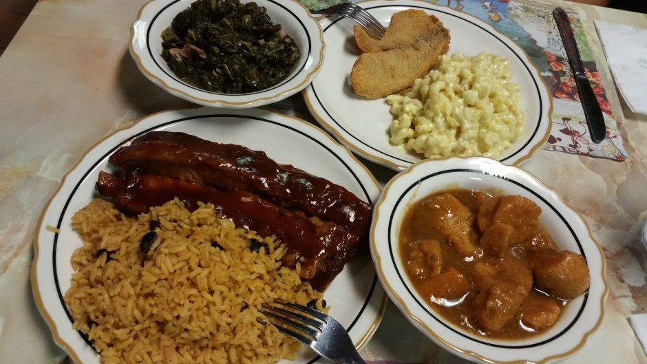 Clockwise from bottom left: pork ribs with rice and beans, collard greens, fried fish with mac and cheese and candied yams at Ronnie's. (Beverly M. Elander)