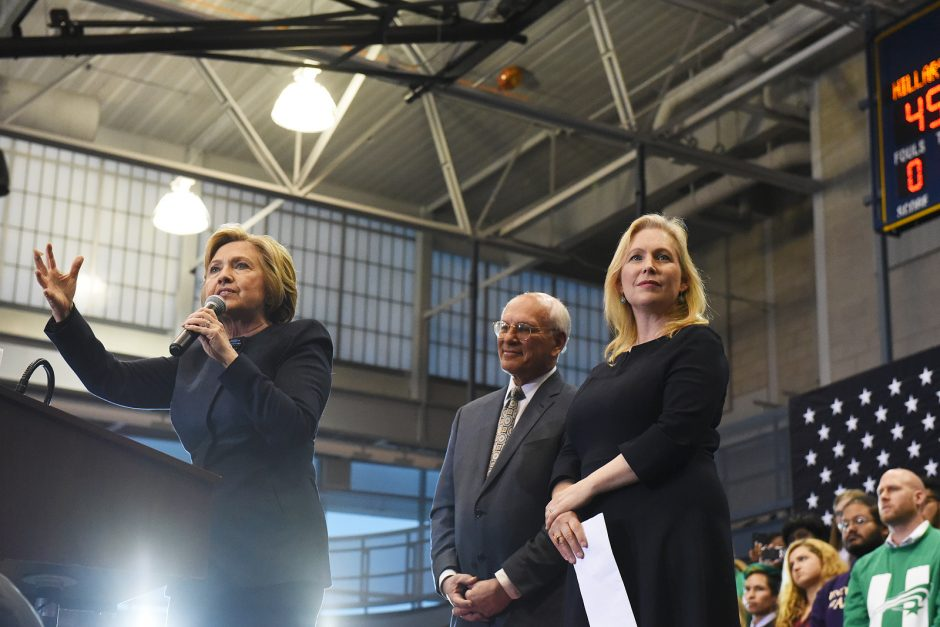 Former Secretary of State Hillary Clinton on stage, beside Congressman Paul Tonko and Senator Kirsten Gillibrand, at Cohoes High School during her visit for a Capital Region Organizing Event on Monday afternoon, April 4, 2016.