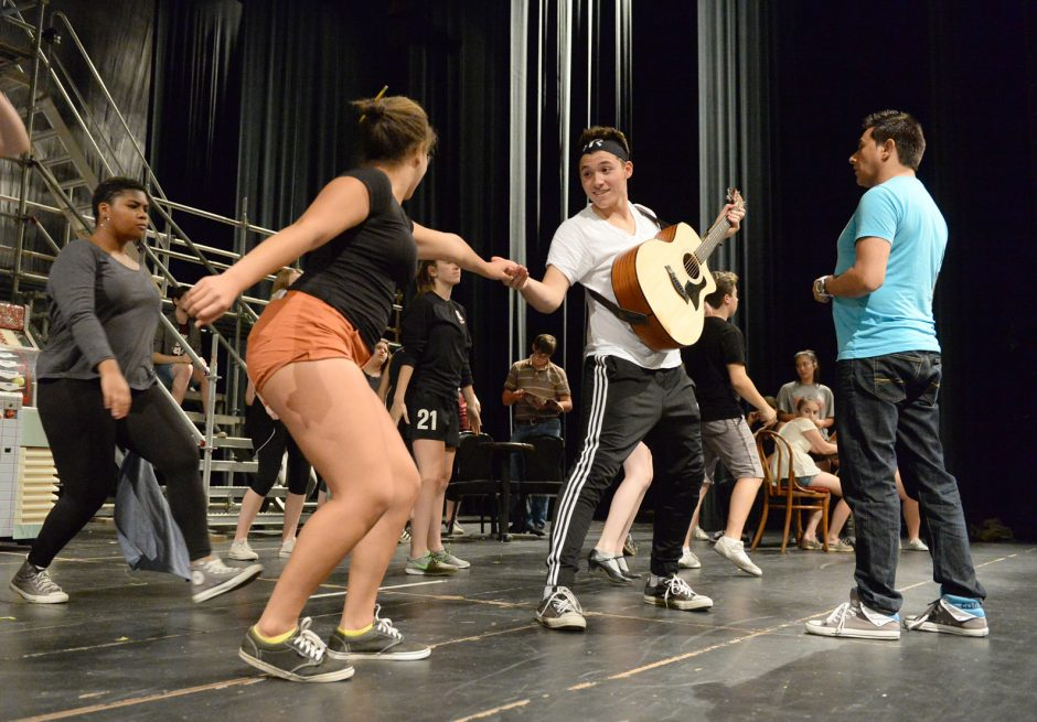 """Choreographer Freddy Ramirez, right, works with students during a recent rehearsal for """"All Shook Up"""" at Proctors."""