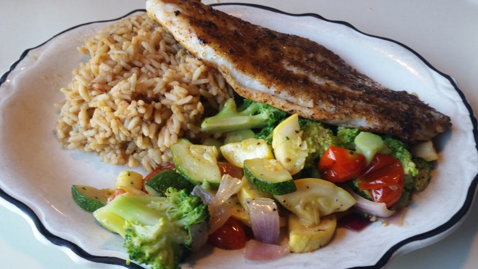 Blackened catfish with rice and mixed vegetables at the Bayou Cafe in Glenville. (Caroline Lee)