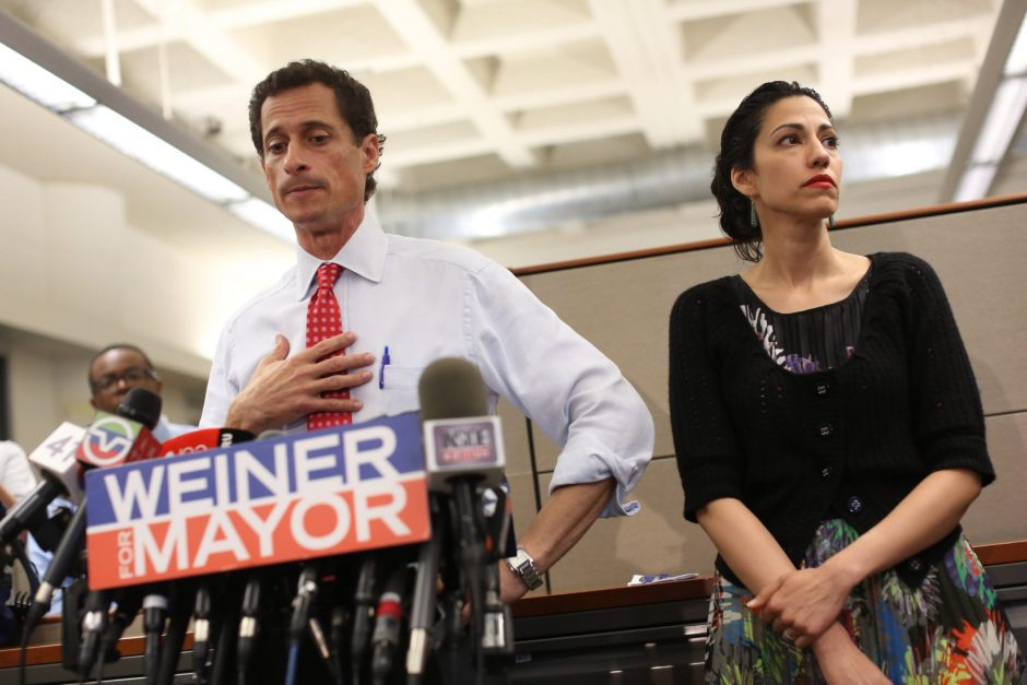 New York City Mayoral candidate Anthony Weiner, with his wife Huma Abedin, during a news conference where addressed revelations that he continued sending raunchy images of himself in online chats after his resignation from Congress in 2011, at the offi...