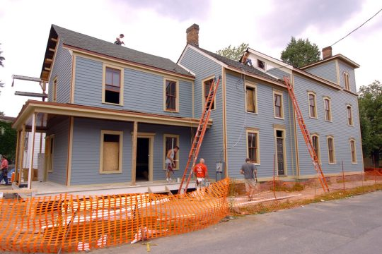 Work crews out siding on the Gillette House on Union Street in July of 2004.