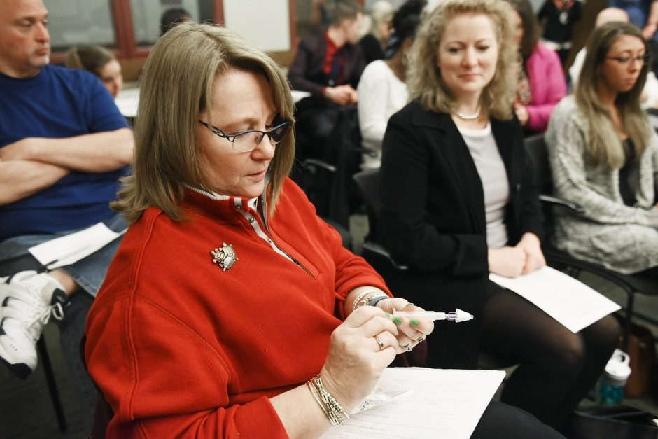 Patsy Berrigan, of Saratoga, tests out Narcan through a free program with Project Safe Point, a Program of Catholic Charities Care Coordination Services in Albany, at the Saratoga Springs Public Library on March 14.