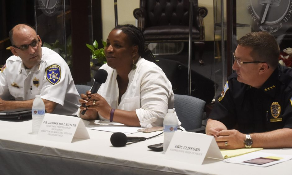 Dr. Deidre Hill Butler, center, makes opening comments with Schenectady County Sheriff Dominic D'Agostino, left, and Schenectady Police Chief Eric Clifford at a forum at the Mt. Olivet Missionary Baptist Church in Schenectady on Wednesday, Sept. 14, 2016.