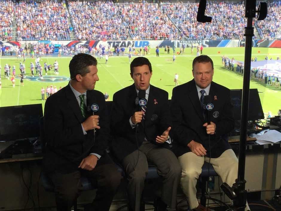 Former WNYT sports reporter Andrew Catalon, center, has been with CBS Sports for seven years. He's shown in the broadcast booth at an NFL game with Steve Beuerlein and Steve Tasker.