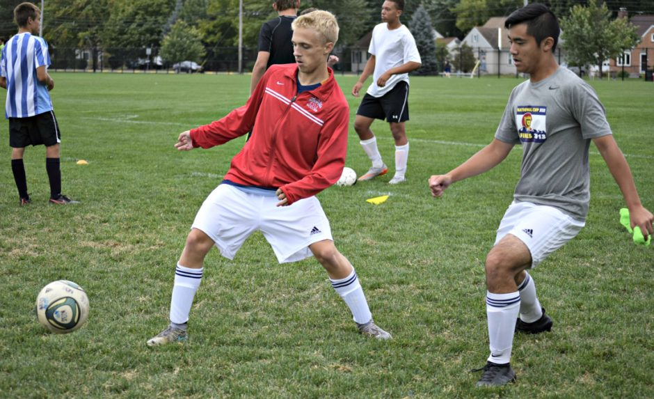 Niskayuna's Alex Koudal, left, makes a pass as teammate Alex Chan defends during practice Friday.