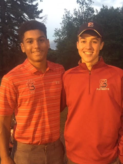 Marcus Griffin, left, with fellow sectional qualifier and Schenectady High School teammate Jason Cyr, has gone from weakest link on the golf team to a force in one season.