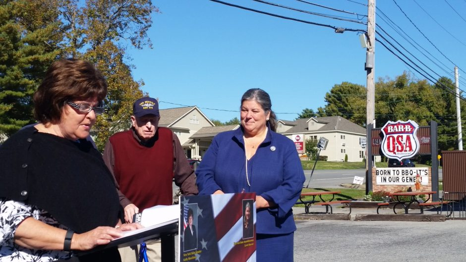 State Sen. Kathy Marchione speaks Thursday at a ceremony designating Route 9 in Saratoga County to honor naval submarine veterans. Veteran Fred Miller and Assemblywoman Carrie Woerner look on.