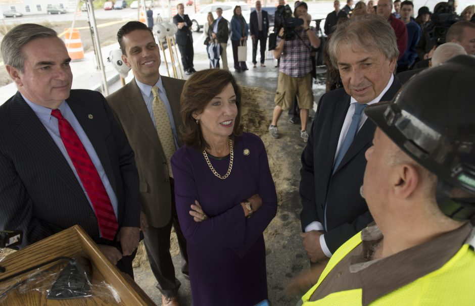 Schenectady Mayor Gary McCarthy, left, Assemblyman Angelo Santabarbara, Lt. Governor Kathy Hochul, and President and CEO of the Galesi Group David Buicko talk with Vice President of Operations Joe Scibetta prior to the ground breaking of a mall and par...