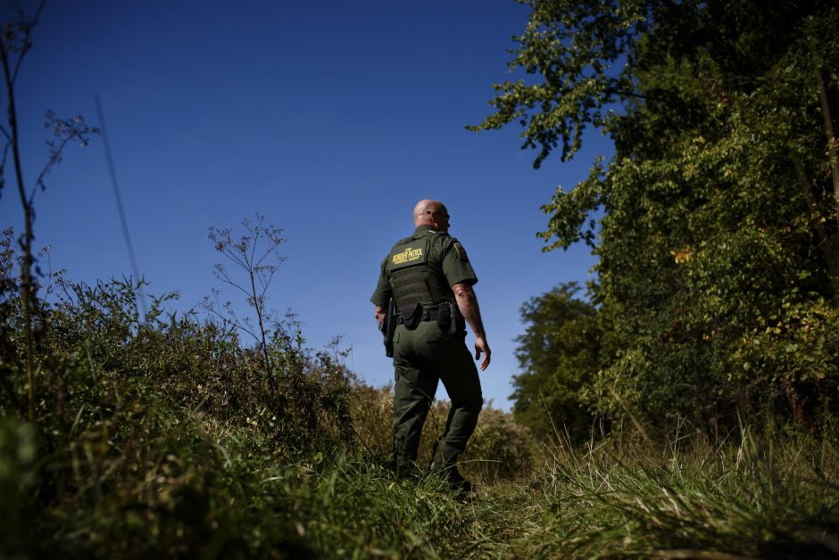 United States Border Patrol agent Norman Lague walks on a trail that runs along the border between the United States and Canada, near Champlain, N.Y., on Sept. 21. The Northern border of the United States is nearly three times the Southern border's len...