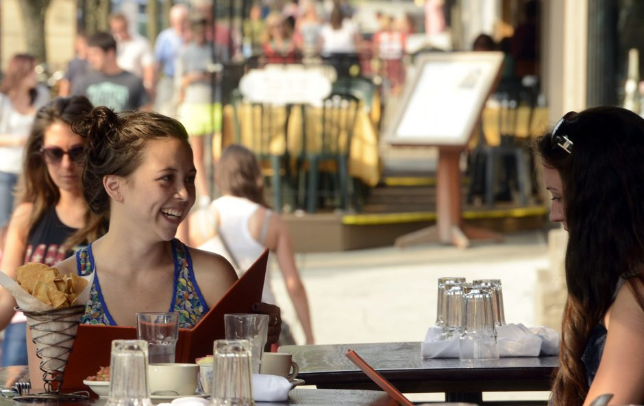 Malysa Cheng of Schenectady, left, and Larissa Winkler of Kingston dine on the patio at Cantina on Broadway in Saratoga Springs in 2013. A new initiative aims to improve public broadband internet access in the city, with the goal of supporting economic...