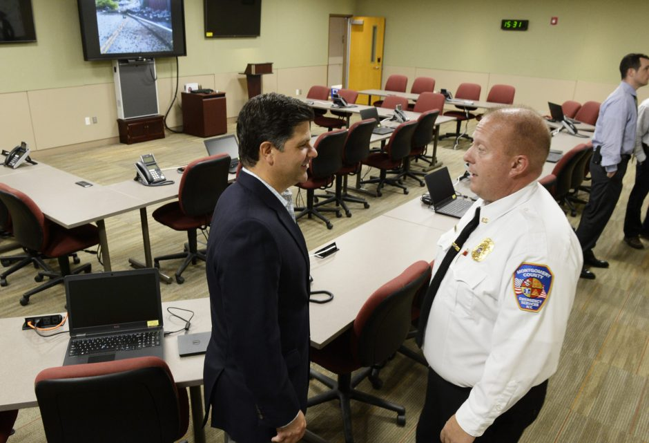 Assemblyman George Amadore, left, and Montgomery County Emergency Management Coordinator Jeff Smith take a tour of the new command center on Wednesday.