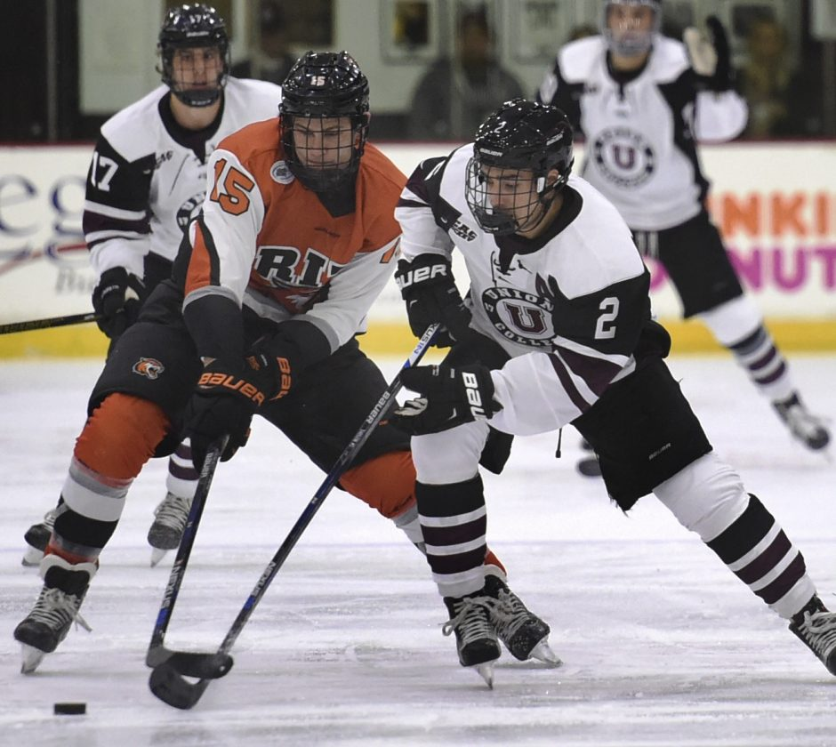 Max Mikowski of Rochester Institute of Technology and Jeff Taylor of Union battle for the puck at center ice Friday at Messa Rink. The Dutchmen won 5-2.