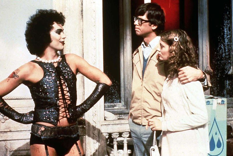 """Tim Curry, left, as Dr. Frank-N-Furter, Barry Bostwick as Brad and Susan Sarandon as Janet in the 1975 film """"The Rocky Horror Picture Show."""" (20th Century Fox)"""