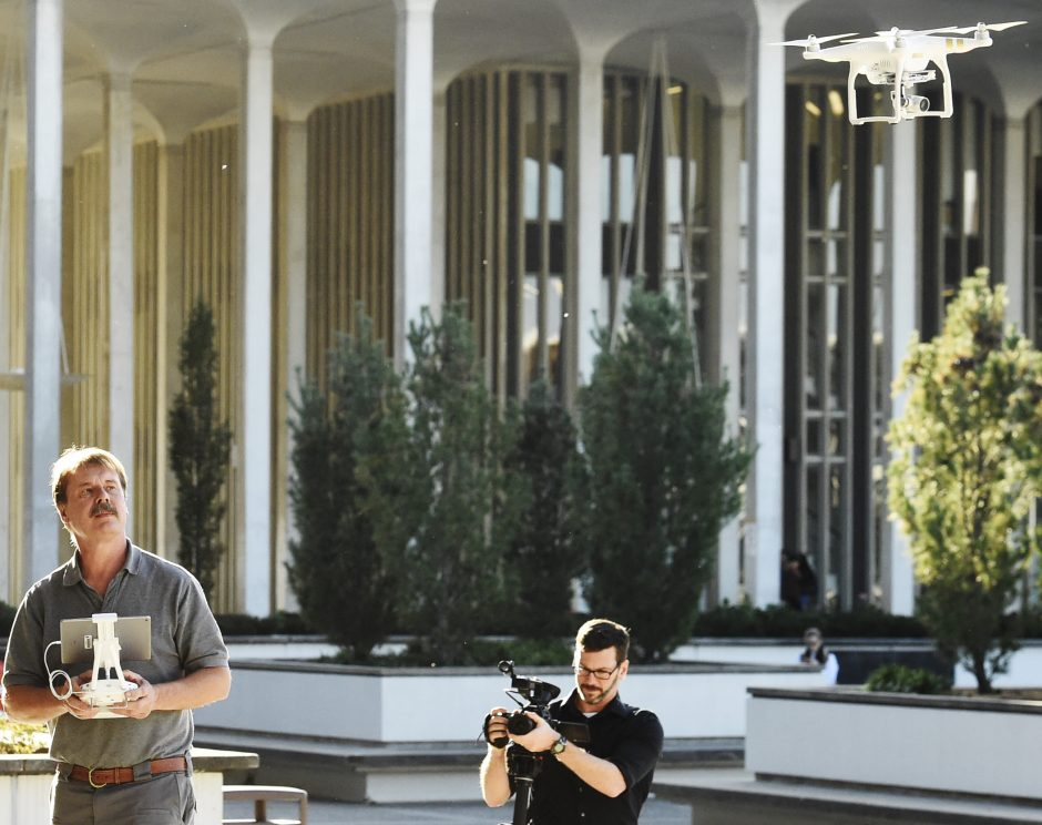 A drone is controlled by Bill Judycki of Mohawk Valley Community College Unmanned Aerial Systems hovers above the Performing Arts Center at UAlbany on Tuesday.