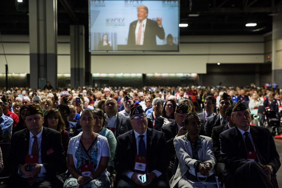Donald Trump speaks at the Veterans of Foreign Wars National Convention in Charlotte, N.C., on July 26. Even as other voters abandon Trump, veterans remain among his most loyal supporters, an unlikely connection forged by the widening gulf they feel fr...