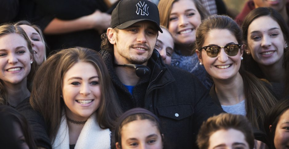 Director James Franco, on location for 'The Pretenders' film at Union College, has his photo taken with students on Monday.