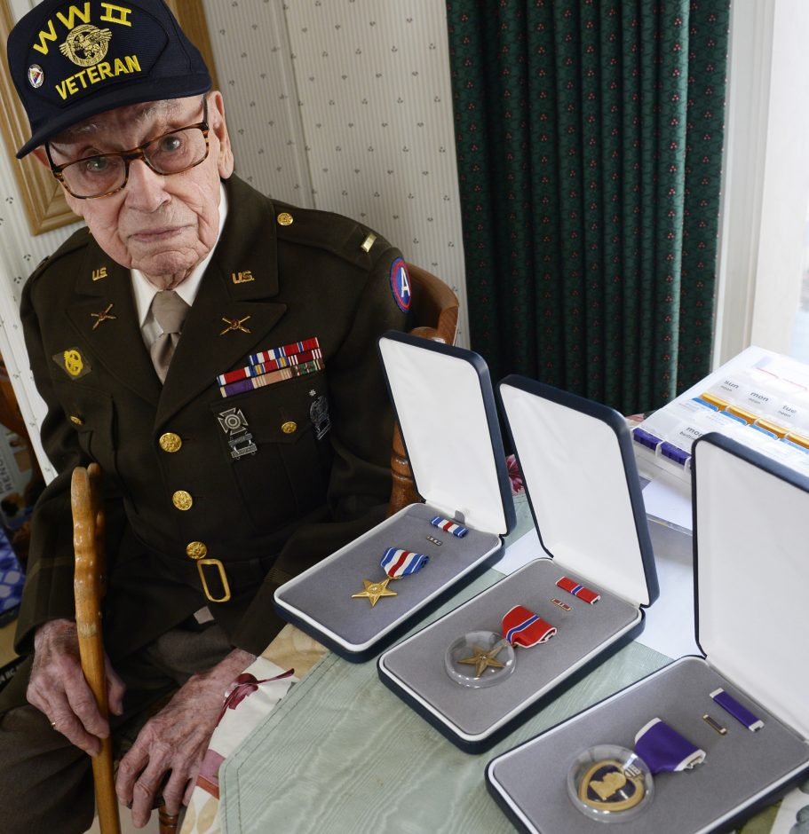 WWII veteran William Butz of Colonie with his three medals - the Silver Star, the Bronze Star, and the Purple Heart - on Thursday.