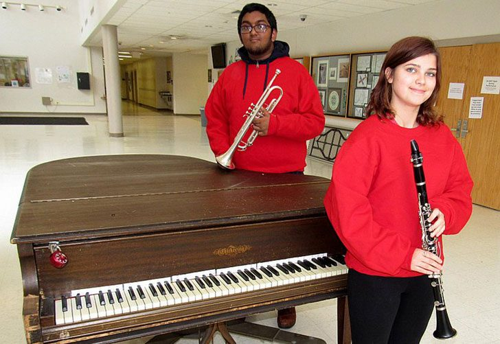 Schenectady High School clarinet player Zoe White and trumpet player Satesh Rajkumar pose near a piano in a school hallway. The musicians love the sights and sounds of the upcoming Daily Gazette Holiday Parade, which will be held Saturday in downtown S...