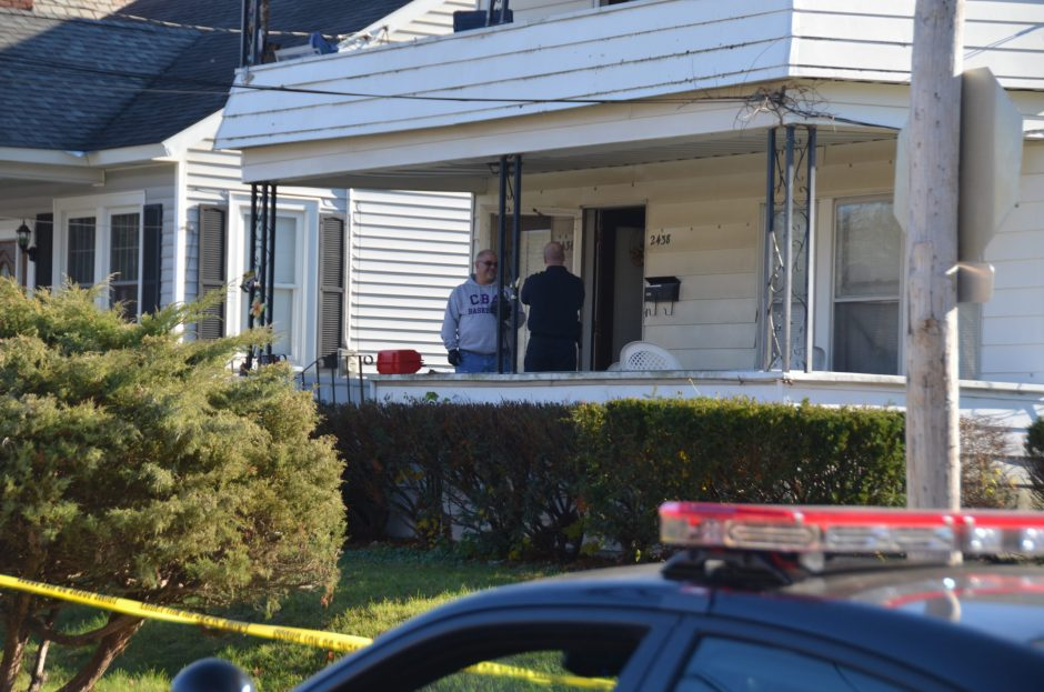 Investigators on the front porch of 2436 Campbell Ave., where the Schenectady Police Department said they found Charles Dembrosky, 49, dead of a gunshot wound to the head.