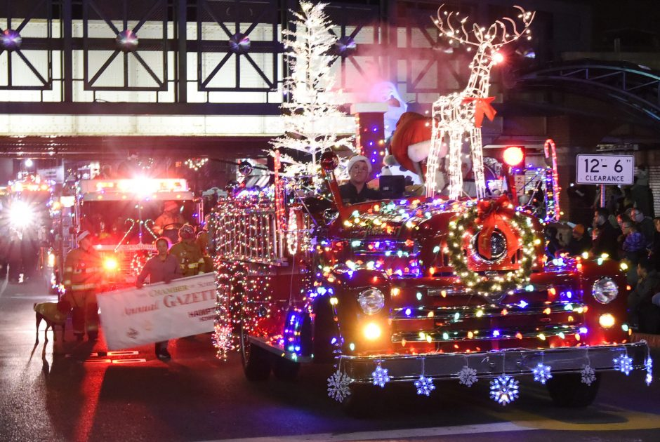 A vintage Seagrave fire engine is covered in lights from the Waterford Fire Department in the annual Gazette Holiday parade on Saturday.