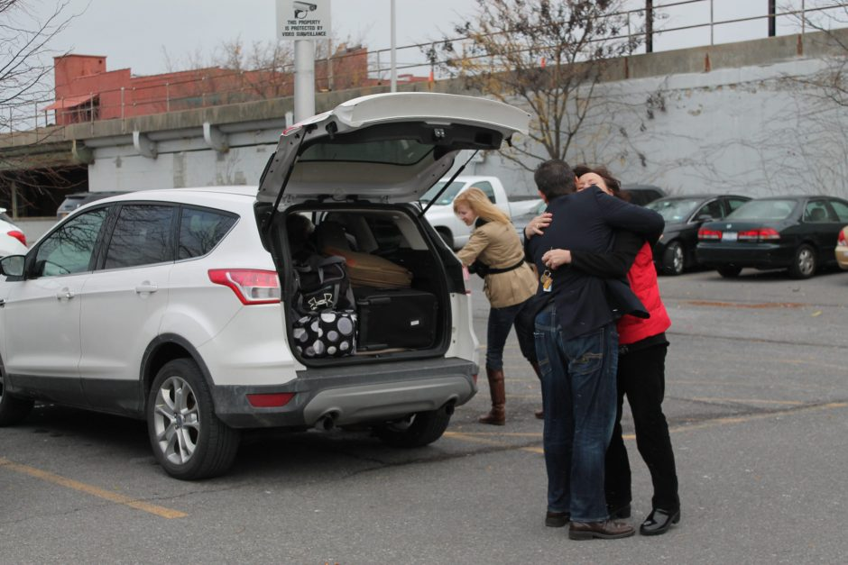 Travelers hug goodbye at the Amtrak station in Schenectady on Monday. More than 3 million New Yorkers are planning to hit the road for the Thanksgiving this year, according to AAA's annual travel survey.