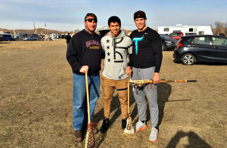 From left, Scott Marr, Lyle Thompson and Bill O'Brien are shown Tuesday at the Standing Rock Indian Reservation in North Dakota. Thompson is a former UAlbany men's lacrosse star, while Marr is the program's head coach.
