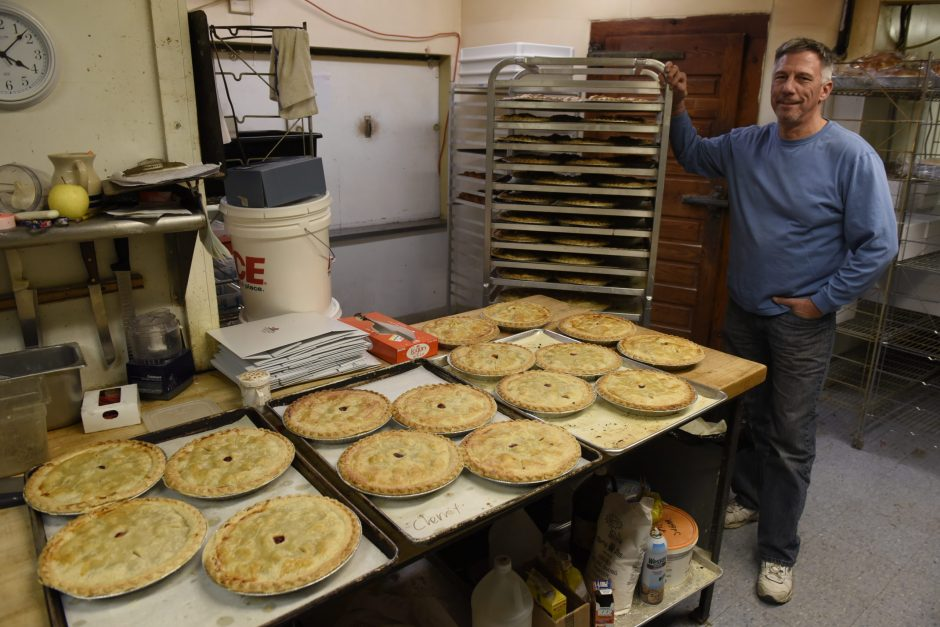 Glenn Hogue, owner of Fo'Castle Farm Country Store in Burnt Hills, stands beside the farm store's trove of freshly baked pies.