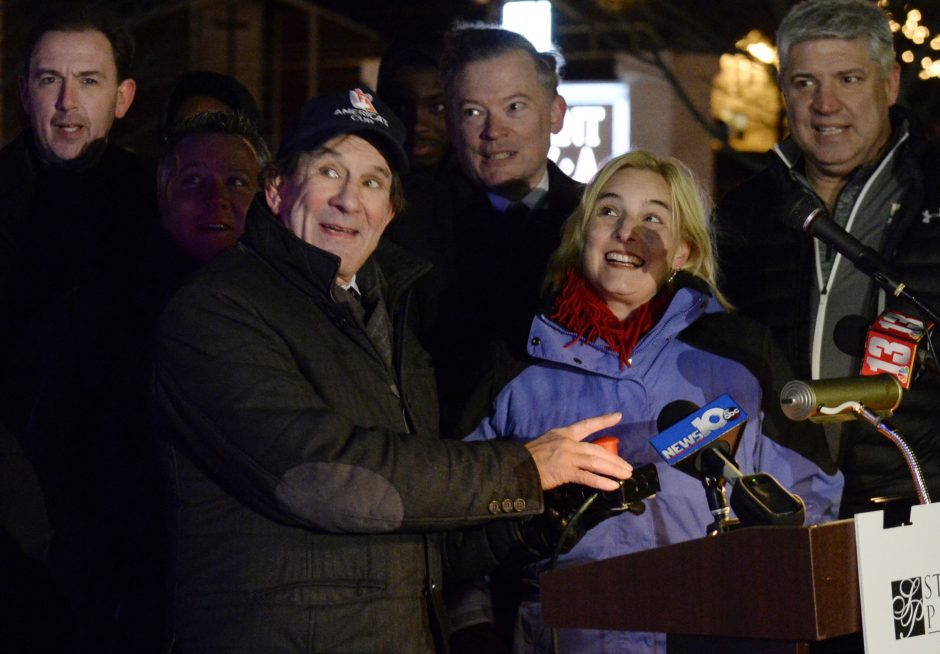 UAlbany basketball coach Will Brown, left, and Siena basketball coach Jimmy Patsos help light the Christmas tree at Stuyvesant Plaza in Guilderland on Tuesday. Ed Swyer, center, pushes the button. Guilderland Town Supervisor Peter Barber is between Bro...