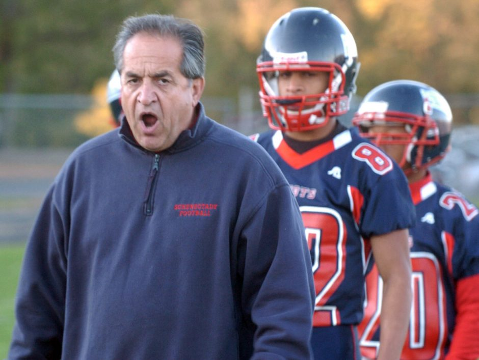 Schenectady football coach Carmen DePoalo shouts encouragement to his team as they practice Thursday night in Mont Pleasant, preparing for the playoffs.