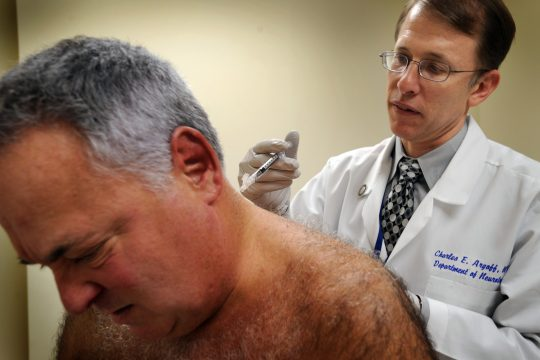 Howard Spector of Long Island receives Botox injections to his neck from Dr. Charles Argoff at Albany Medical Center.
