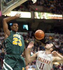 Siena's Edwin Ubiles nails a shot as Albany's Anthony Raffa watches in first half action in college basketball action played Saturday night at the Times-Union Center.
