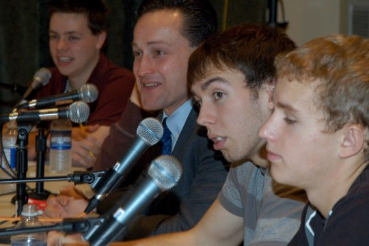 Schoharie High School students Tyler Duma, far left, and Jeremy LaJeunesse, right, along with Assemblyman Pete Lopez, center, listen to a question Wednesday morning at WAMC.