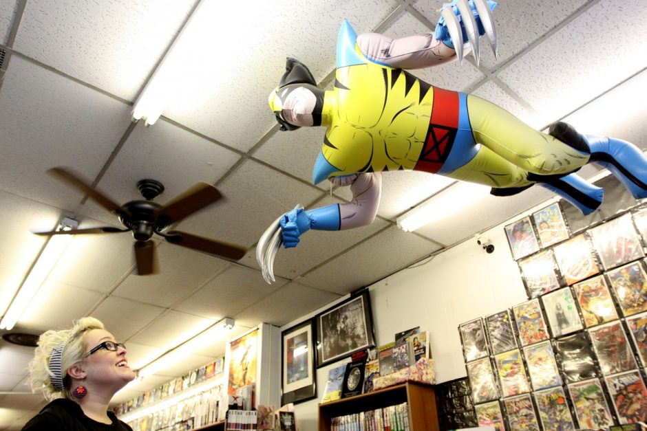 Alicia Messineo of Rotterdam, assistant manager at Earthworld Comics in Albany, looks up at an inflatable Wolverine hanging from the ceiling in the store Friday afternoon.