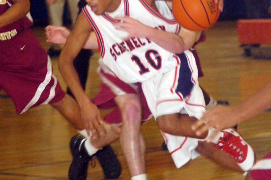 Schenectady's Shabar Fennicks drives the ball past ND-BG's Brian Hamor in third period action Friday at the Pat Riley complex.