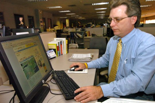 Mark Robarge, online editor for The Daily Gazette, updates the newspaper's Web site, dailygazette.com, from his desk in the paper's newsroom Thursday morning.