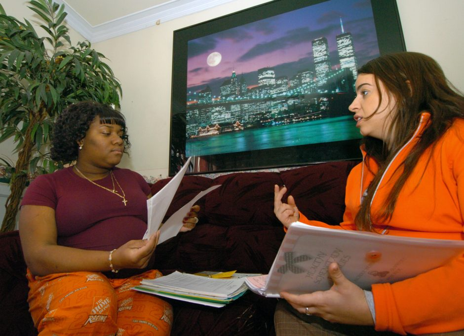 Catholic Charities Nicole Webber, right, talks with J'nai Lawrence Grimes at her mothers home on Thurday afternoon. Grimes is part of Catholic Charities Healthy Families Program, that supports pregnant women. It offers advice to expectant mothers an