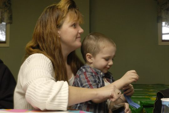 Tonya Walendziak and her son, Garriet Buseck, 4, sit together at a benefit held for Walendziak at the Moose Lodge in Gloversville on Sunday.