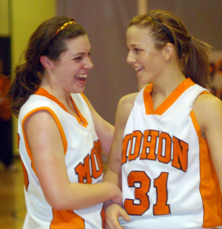 Standing on the foul line in the third quarter, Nicole Adach of Mohonasen, right, gets a congratulatory hug from teammate Dayna Lashin moments after Adach scored the 1,000 point plateau in a Tuesday night game played against visiting Colonie.