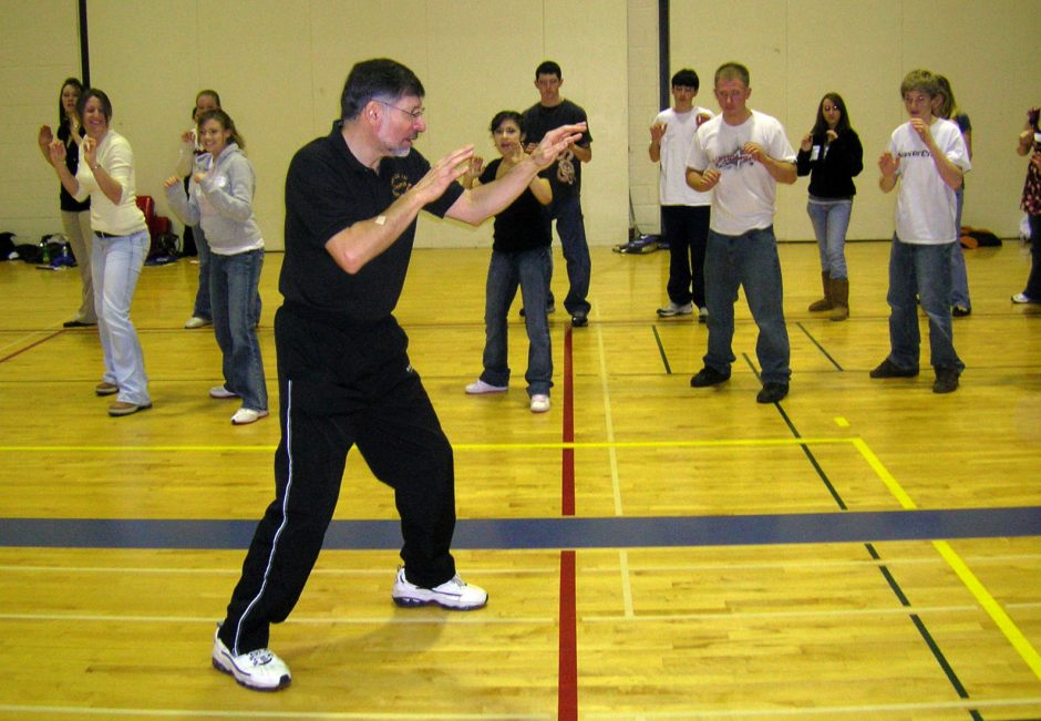 Mike Campos of Zen Do Zai Martial Arts in Johnstown demonstrates the proper self-defense stance for high-school students attending the 2008 Choices Summit at Fulton-Montgomery Community College Wednesday.