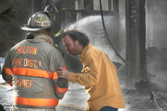 Joe Murphy, right, is distraught upon seeing his home on Lester Lane in Middle Grove gutted by fire Thursday morning.