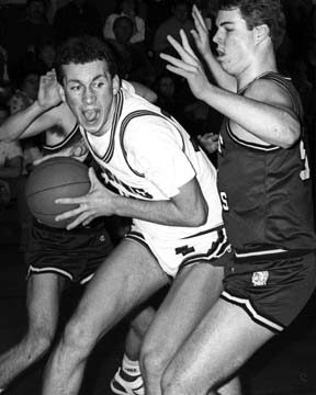 Scotia's Glen Arnold drives toward the basket against Burnt Hills-Ballston Lake's Mark Schneible on Feb. 5, 1988. Burnt Hills won the game, 39-33. The style of shorts was much different than today's long, baggy variety.