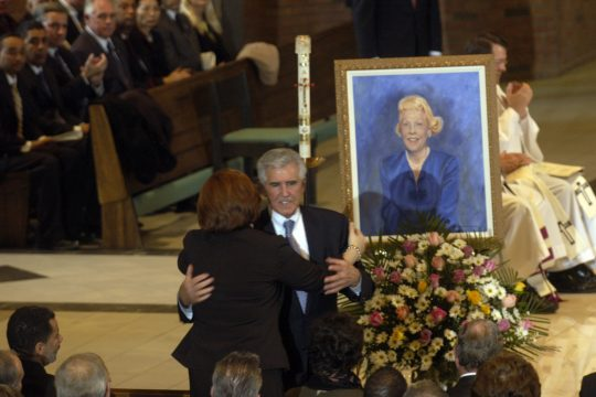 """State Senate Majority Leader Joseph Bruno receives a hug after delivering the eulogy for his late wife, Barbara """"Bobbie"""" Bruno, at St. Pius X Church in Loudonville on Monday."""