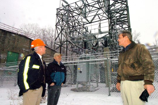 John Holmes, Corporate Council for Cobleskill Stone Quarry, right, talks with Paul Bascomb, center, Stone Quarry Manager and Superintendent, and Thomas Wind, far left, NationalGrid manager of the Energy Service Solutions Division at the Howes Cave quarry