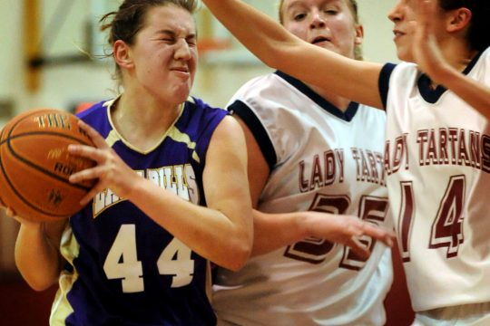 Katie Kollar of Johnstown, left, drives to the basket while being blocked by Shelby Snyder of Scotia-Glenville and teammate Leigha Motta on Tuesday.